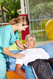Senior man with physiotherapist Royalty Free Stock Image