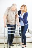 Senior man at physiotherapy at home Royalty Free Stock Photography