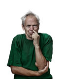 Senior man picks his nose Royalty Free Stock Images