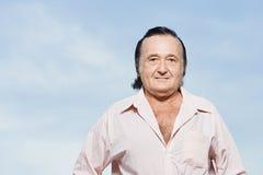 Senior man in a pink shirt royalty free stock image
