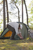 Senior man pitches a tent Royalty Free Stock Images