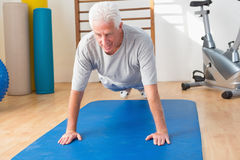 Senior man in plank position Stock Image