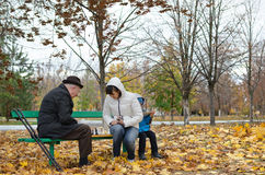 Senior man planning his next chess move sitting in park banch Royalty Free Stock Photos