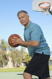 Senior Man Playing Basketball Stock Image