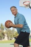 Senior Man Playing Basketball Stock Image