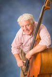 Senior man playing bass. Stock Photography