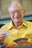 Senior man playing bridge Stock Images