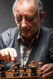 Senior man playing chess Royalty Free Stock Images