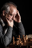 Senior man playing chess Stock Images
