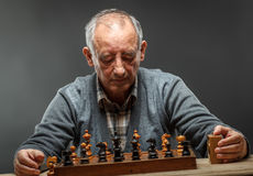 Senior man playing chess Royalty Free Stock Photo
