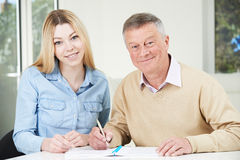 Senior Man Playing Completing Sudoku Number Puzzle With Teenage Royalty Free Stock Images