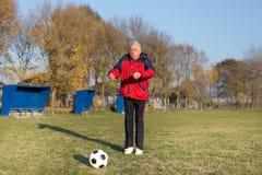 Senior man playing football Stock Photo