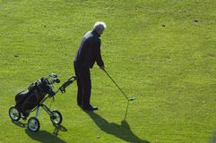 Senior man playing golf stock photo