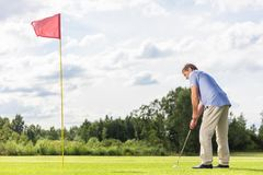 Senior man playing golf. Stock Photography