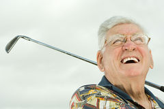 Senior man playing golf Stock Images