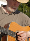Senior man playing guitar Royalty Free Stock Photo