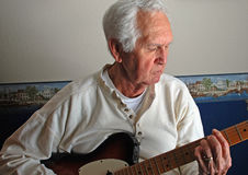 Senior Man Playing Guitar Stock Photography