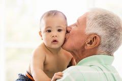 Senior man playing with his grandson Stock Image