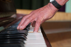 Senior man playing piano Stock Photography