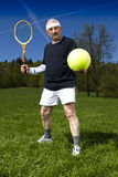 Senior man playing tennis Royalty Free Stock Photo