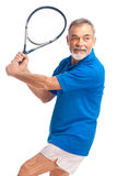 Senior man playing tennis. Isolated on white Royalty Free Stock Photography
