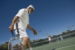 Senior Man Playing Tennis Royalty Free Stock Images