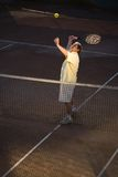 Senior man playing tennis Stock Photos