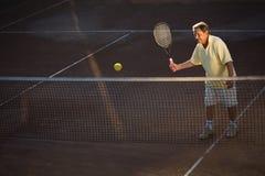 Senior man playing tennis Royalty Free Stock Photography