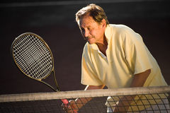 Senior man playing tennis Royalty Free Stock Image