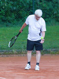 Senior man playing tennis Stock Image