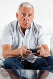 Senior Man Playing Video Game Stock Image