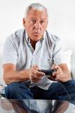 Senior Man Playing Video Game Stock Image