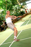 Senior man plays badminton. Royalty Free Stock Photography