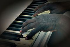 Senior man Plays Piano Stock Images
