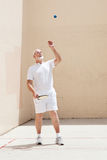 Senior Man Plays Racquetball Stock Photo