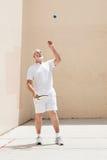 Senior Man Plays Racquetball Stock Photo