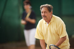 Senior man plays tennis Royalty Free Stock Photos