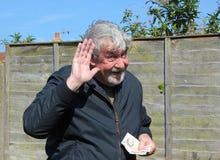 Senior man pleased receiving money. Stock Images
