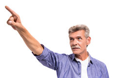 Senior man. Is pointing with finger away, on white background royalty free stock images
