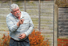 Senior man pointing his finger and angry. stock images