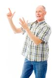 Senior man pointing upward Stock Images