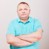 Senior man in polo over white Royalty Free Stock Photo