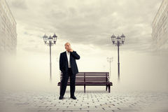 Senior man is pondering Royalty Free Stock Photo