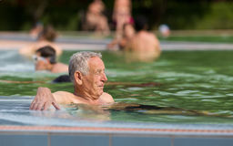 Senior man in the pool Royalty Free Stock Photo