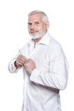 Senior man portrait fasten shirt Royalty Free Stock Photography