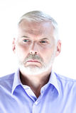 Senior man portrait  pucker displeased Royalty Free Stock Images