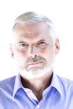 Senior man portrait puckering sullen Stock Images