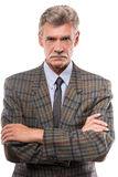 Senior man. Portrait of serious senior man is posing isolated on white background stock photo