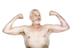Senior man portrait showing biceps cheerful Stock Image
