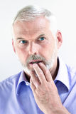 Senior man portrait stun pensive Stock Photography